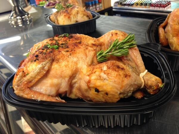Whole roasted Turkey in a takeout catering dish